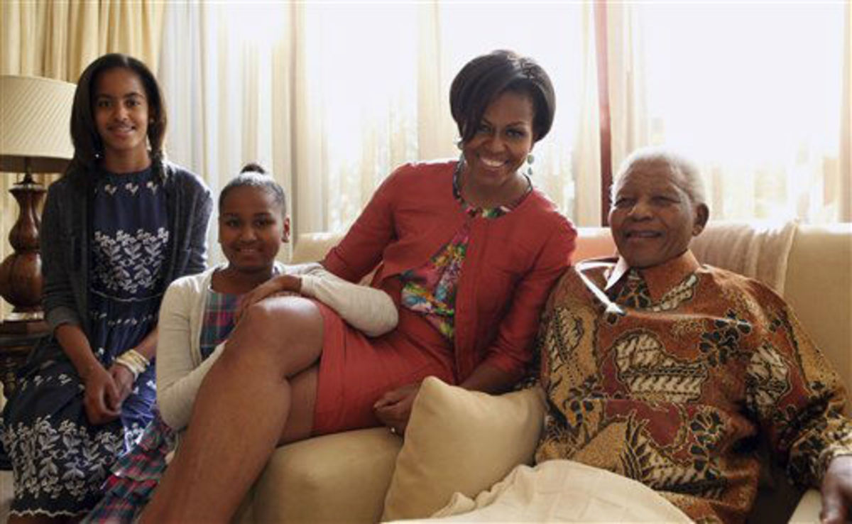 First Lady Michelle Obama and daughters met Nelson Mandela at his home in South Africa June 21, 2011