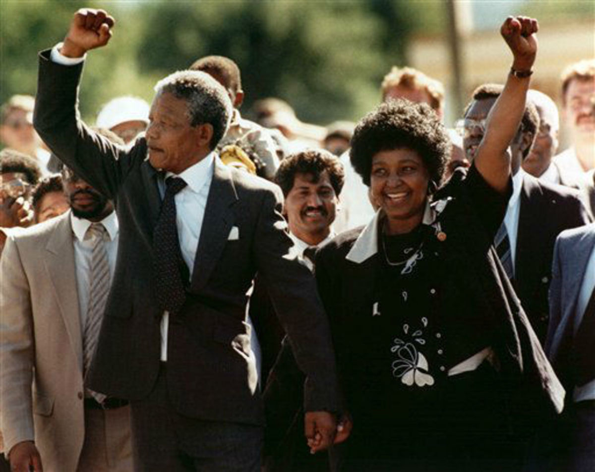 Sunday Feb. 11, 1990 file photo, Nelson Mandela and his then wife Winnie, walk hand in hand upon his release from Victor prison, Cape Town, South Africa.