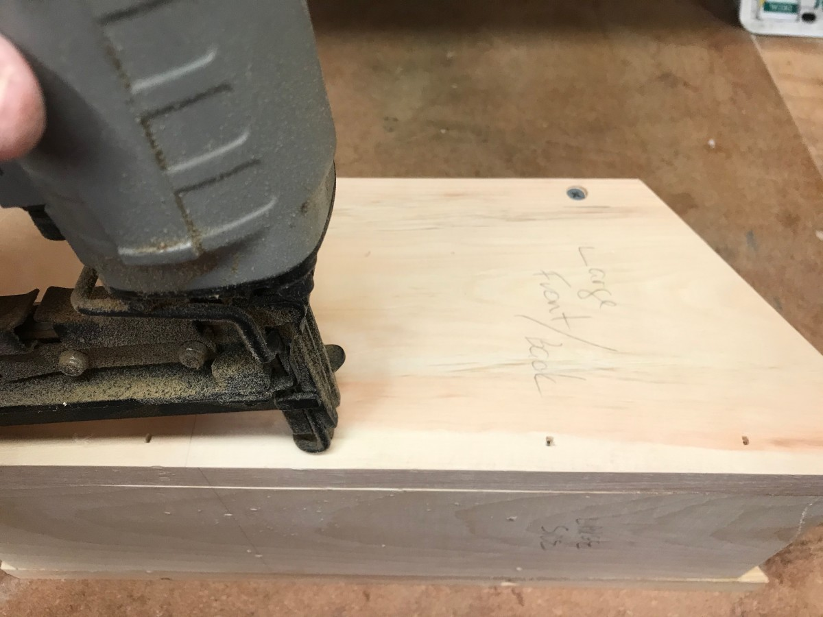 A pneumatic brad nailer makes assembly quick and easy