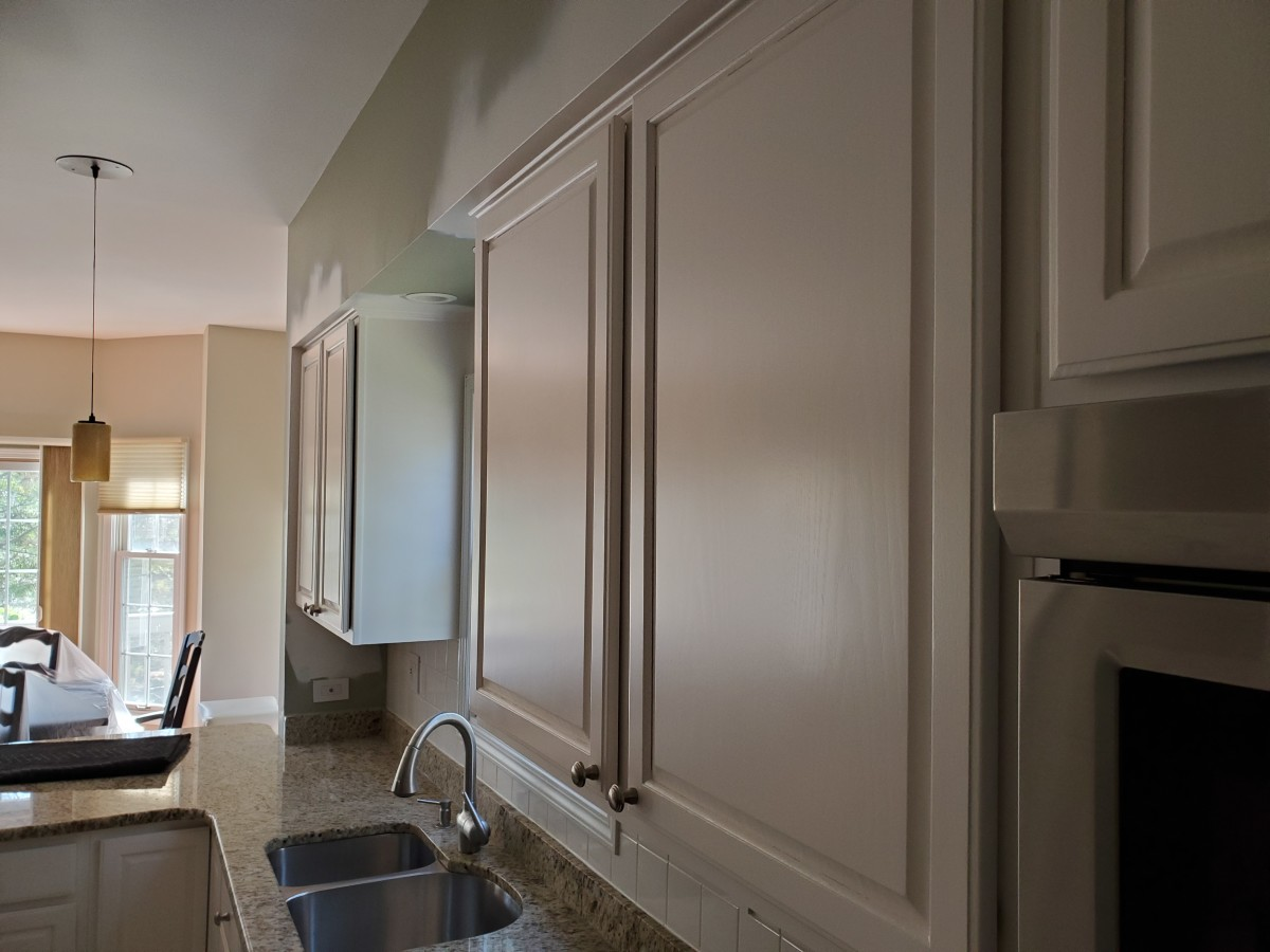 Cabinet doors I sprayed with lacquer in a low gloss finish. The finish is similar to semi-gloss.