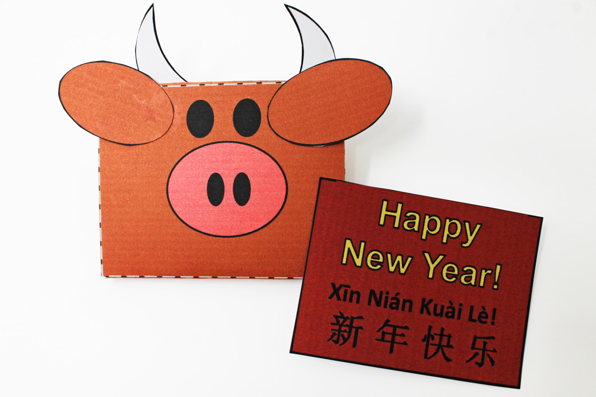 Using a printable template, children can print, cut, and assemble this ox envelope and card.