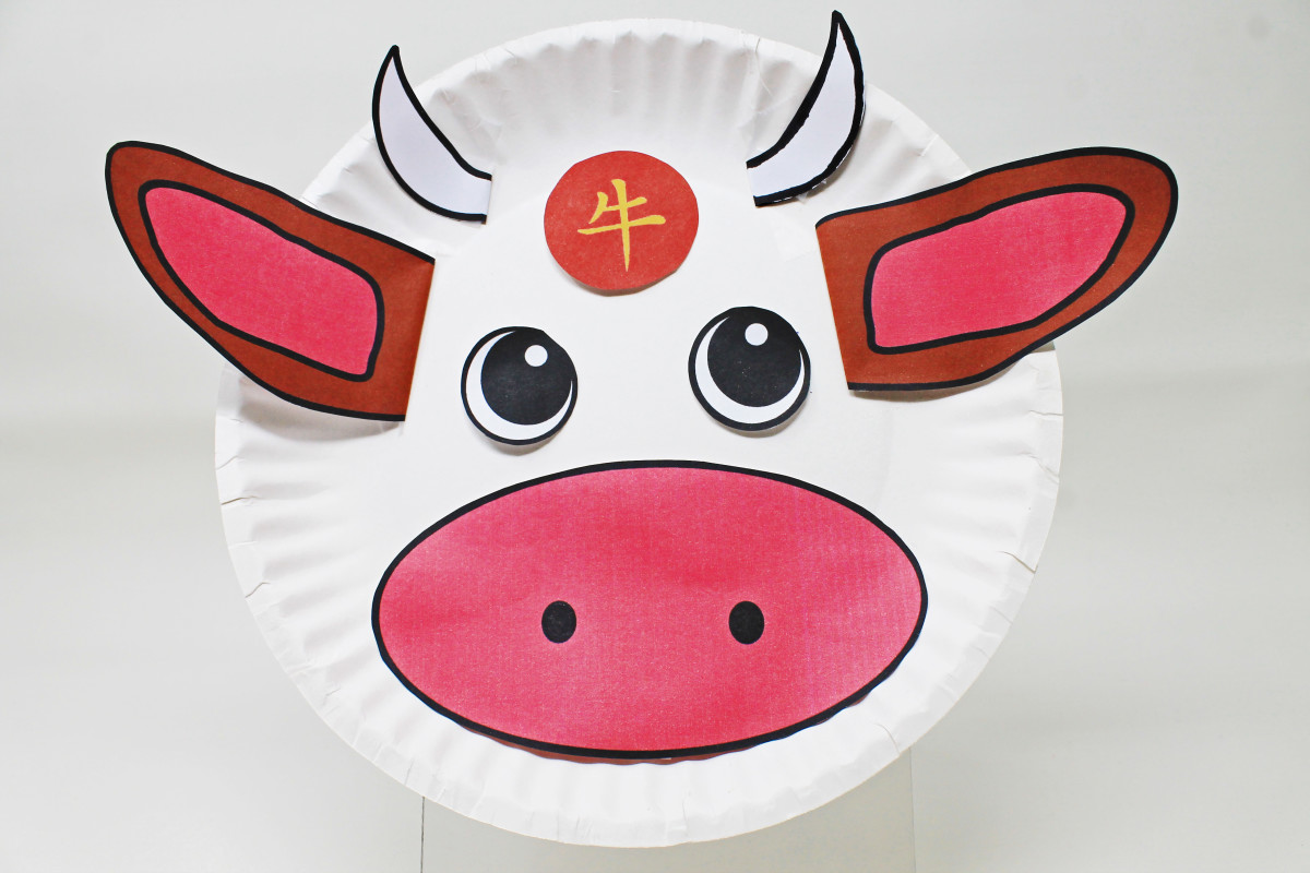 Using a printable template, children can color, cut, and assemble this paper plate Year of the Ox decoration.