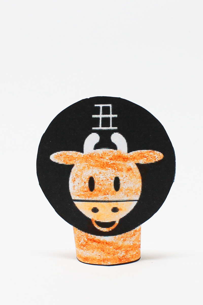 Using a printable template, children can color, cut, and assemble this finger puppet.