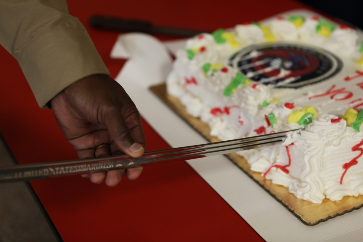 Sergeant Major Allen L. Tanner, the Special Purpose Marine Air Ground Task Force 26 sergeant major uses a Mameluke sword to cut the cake at the Staten Island Marine Corps League Nov. 3, 2009.