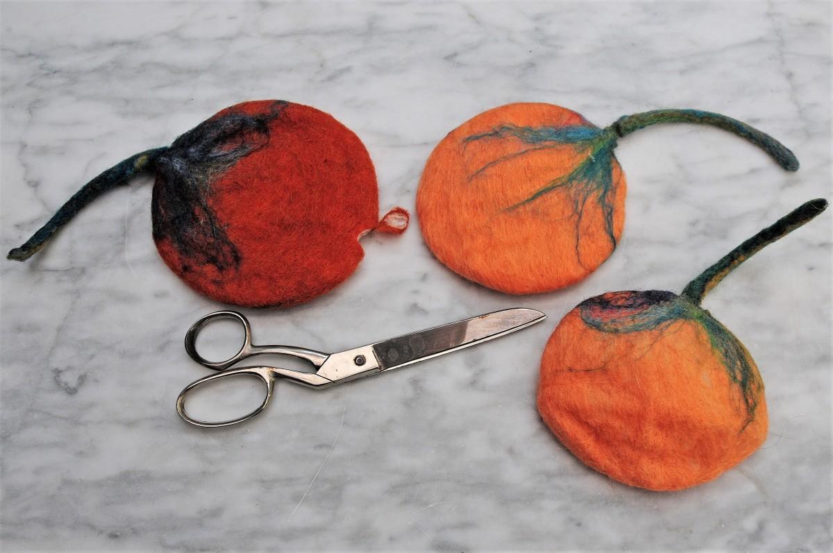 Cut a small hole as shown in each pumpkin