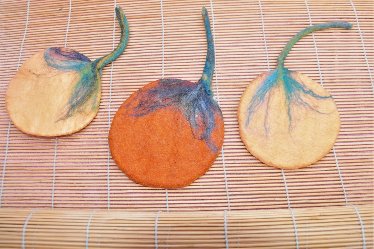 3 wet felted pumpkins in the making.