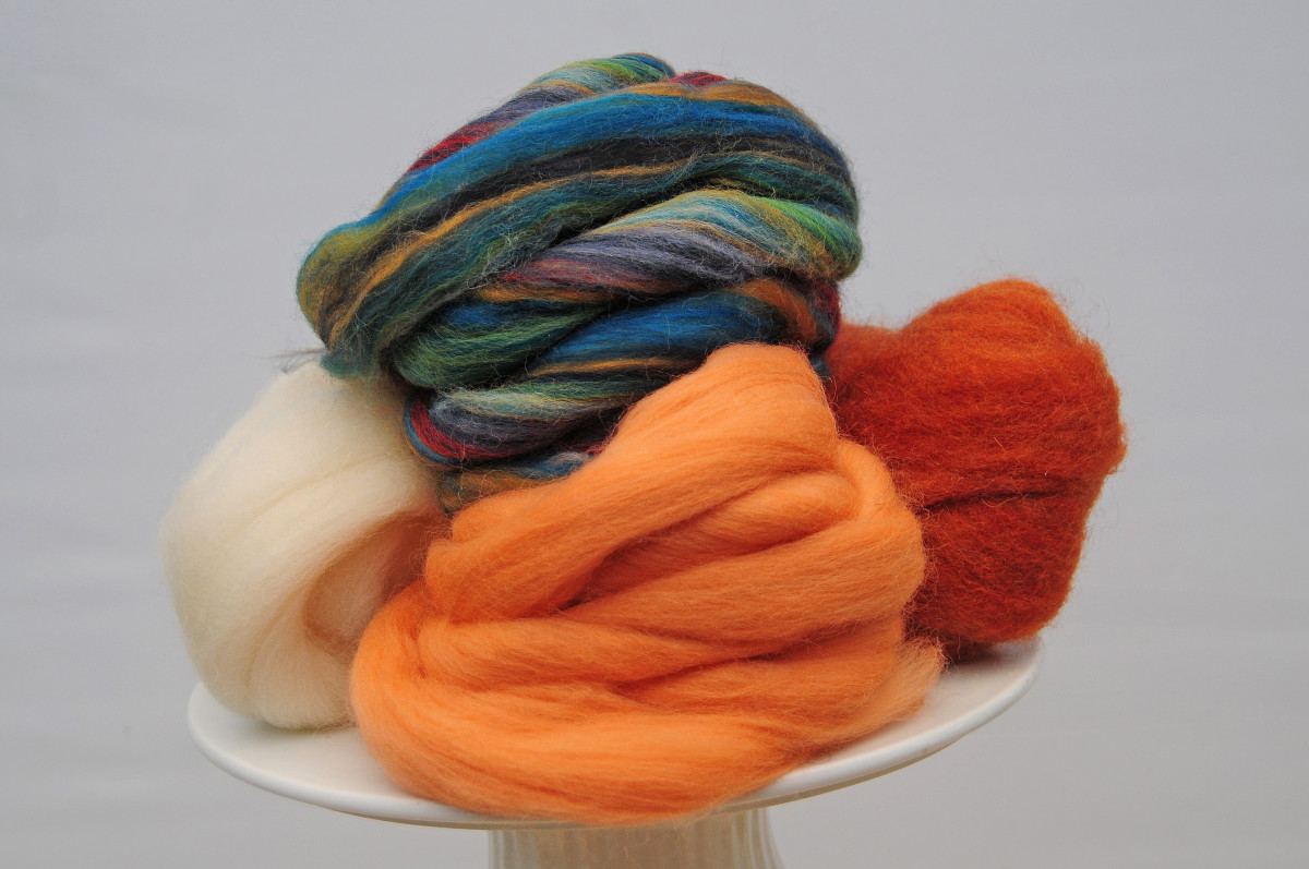 Wool Roving, the green blend is a perfect example of what can be used for a realistic stem.