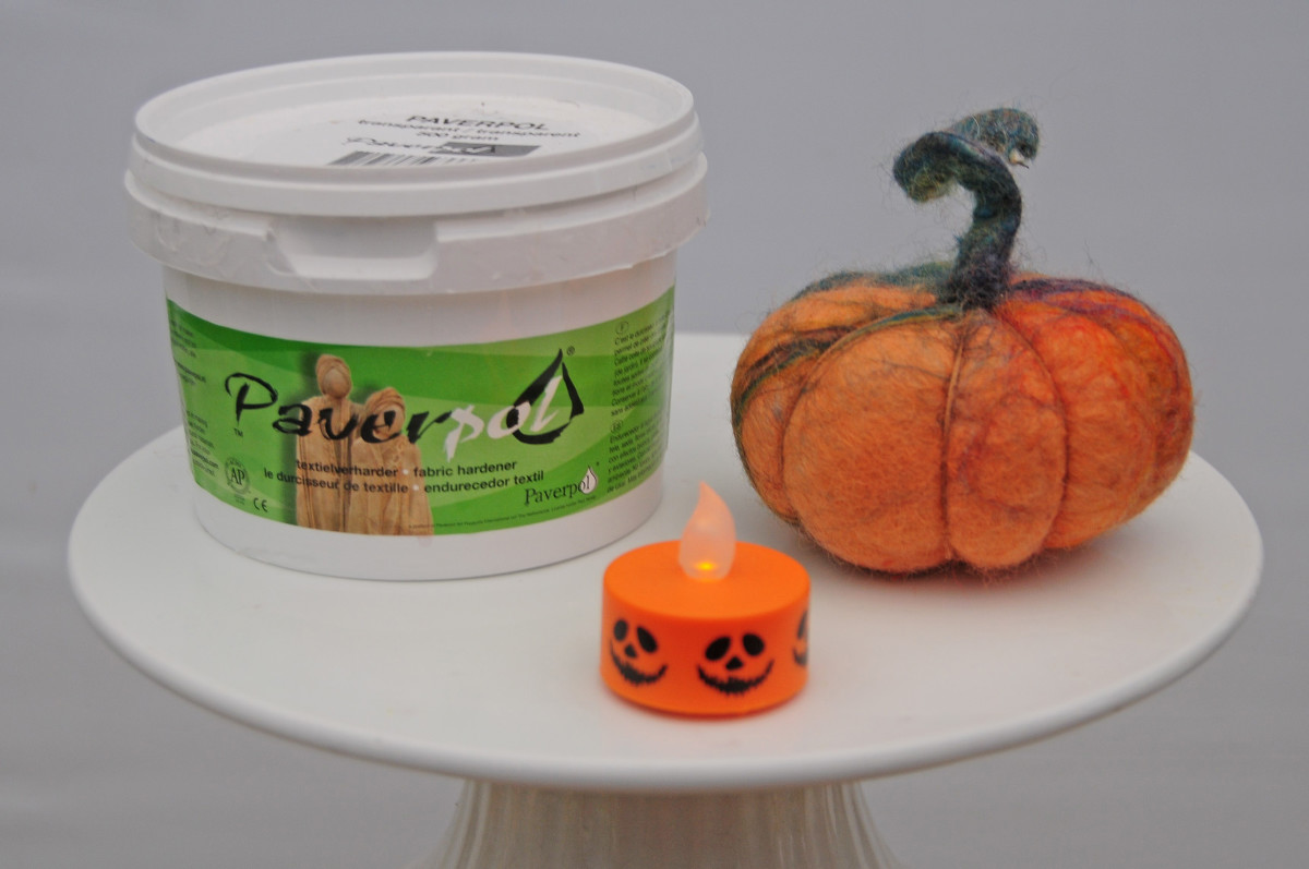 Paverpol (translucent), a small tealight and a completed decorative felt pumpkin.