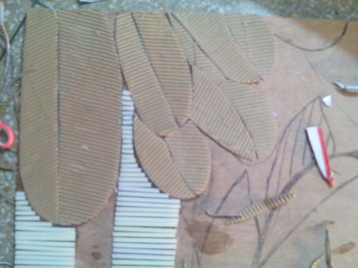 Cardboard pieces cut into leaf shapes and pasted, straws pasted but later i used ice creams sticks instead and painted them in shades of brown and  black