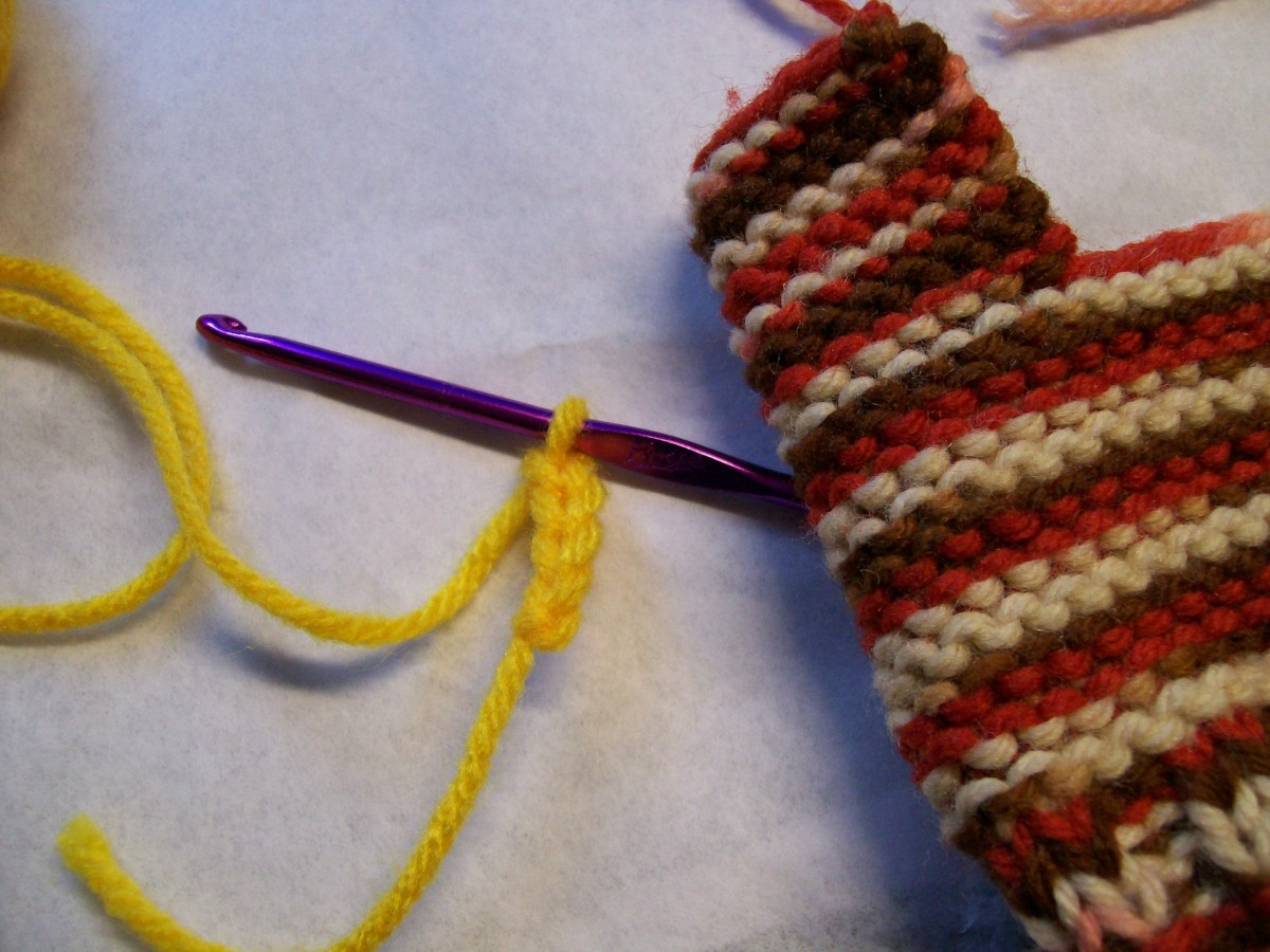 Make the Beak with about 3-4 chain stitches. Leave long ends to attach it.