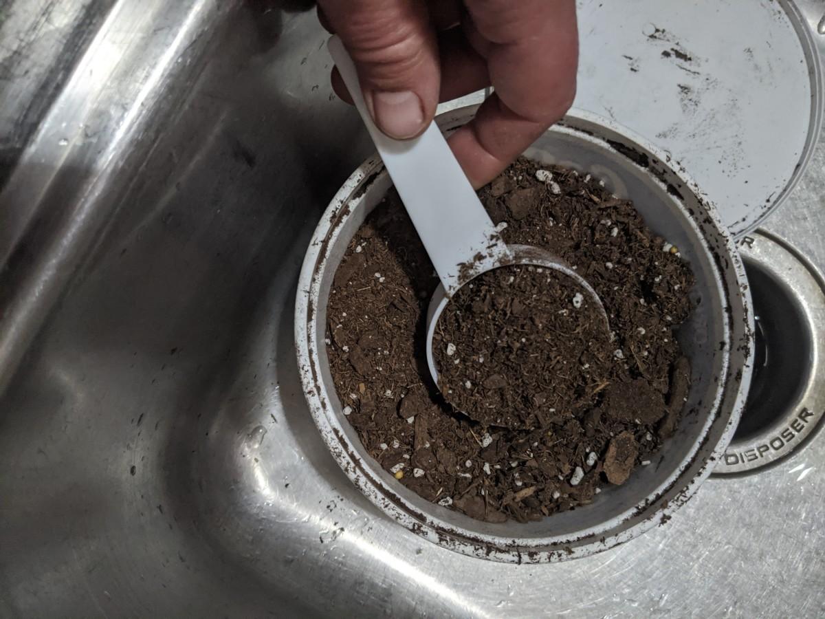Scoop potting soil