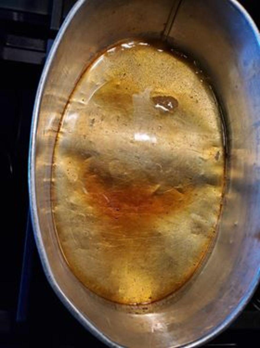 Photo 3. Hardened/cooled caramel at bottom of llanera.