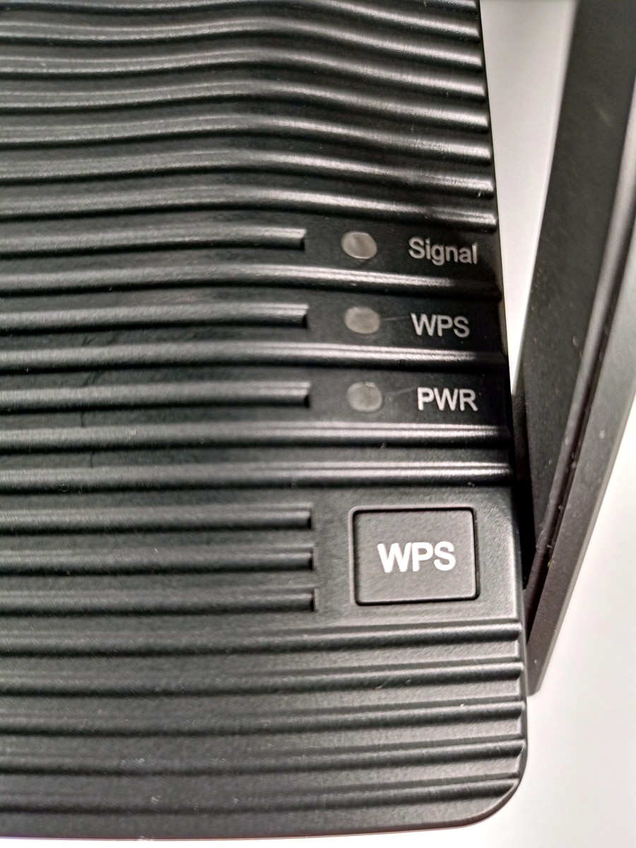 Close up view of WPS button as well as the WPS, power, and signal LEDs