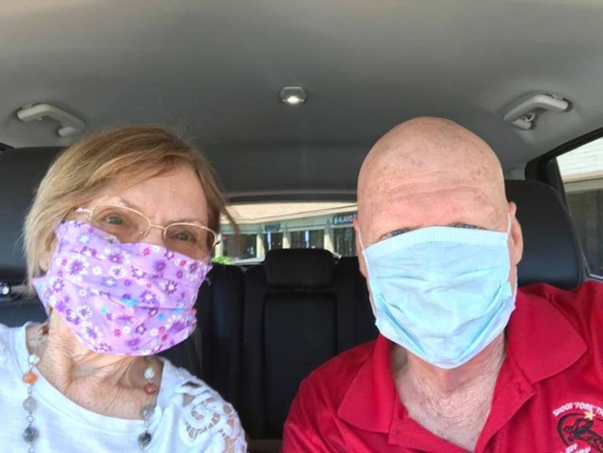 my husband and me wearing our masks faithfully!