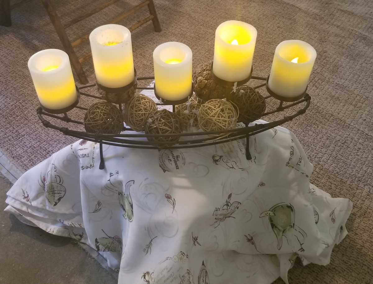 This candelabra helps create ambiance for garage dining. The base is a simple crate covered with a piece of fabric.