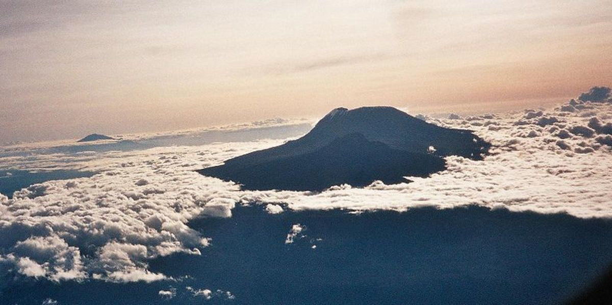 Aerial view of Kilimanjaro, showing ice fields on Kibo peak.  Image by clem23, courtesy of Wikimedia Commons.