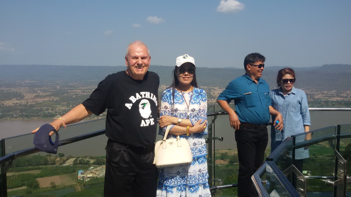 Author with wife on the Glass Skywalk at Wat Pha Tak Suea. (Taken in January 2019.)