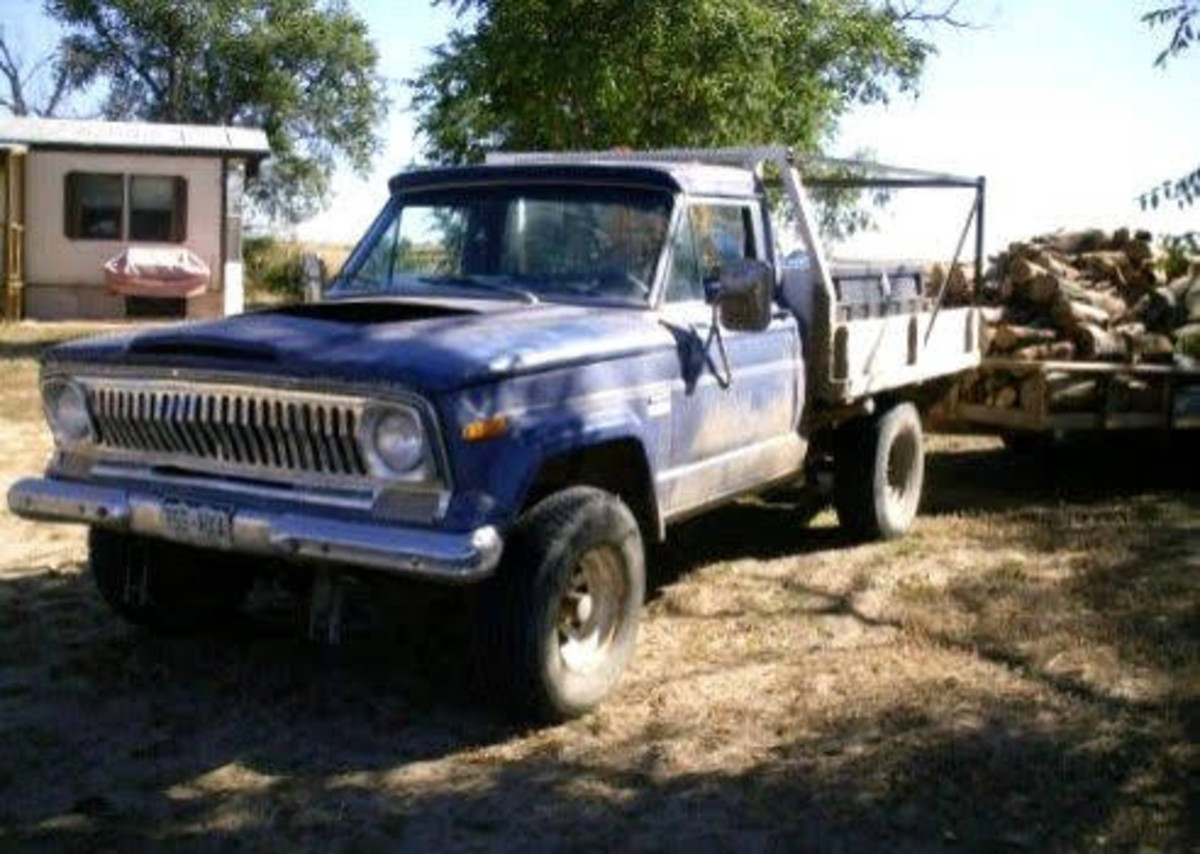 The 1976 flatbed Jeep, helping with everyday business--sometimes sheet metal construction, but today, firewood.