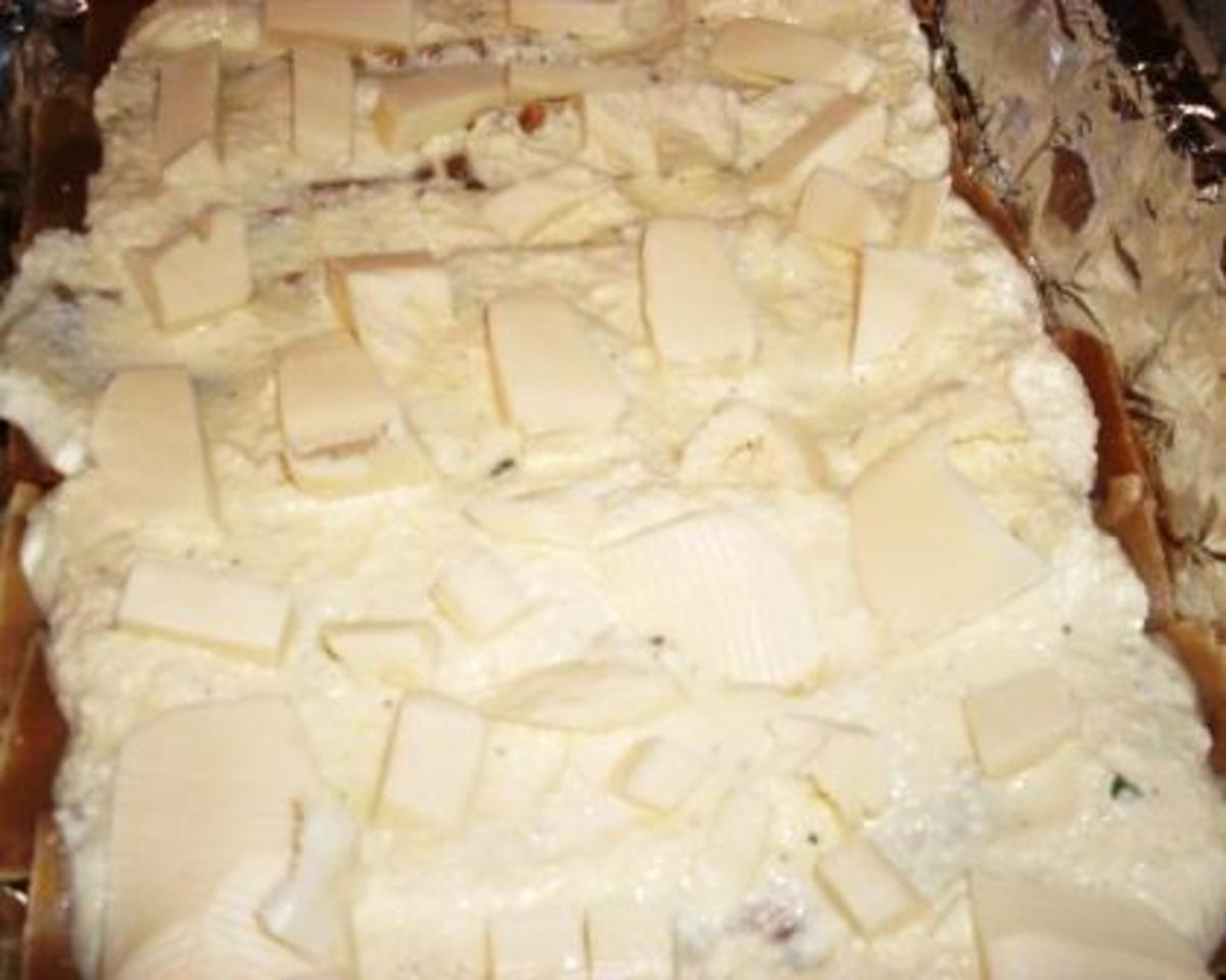 spread some small cubes of mozzarella evenly on top of the ricotta
