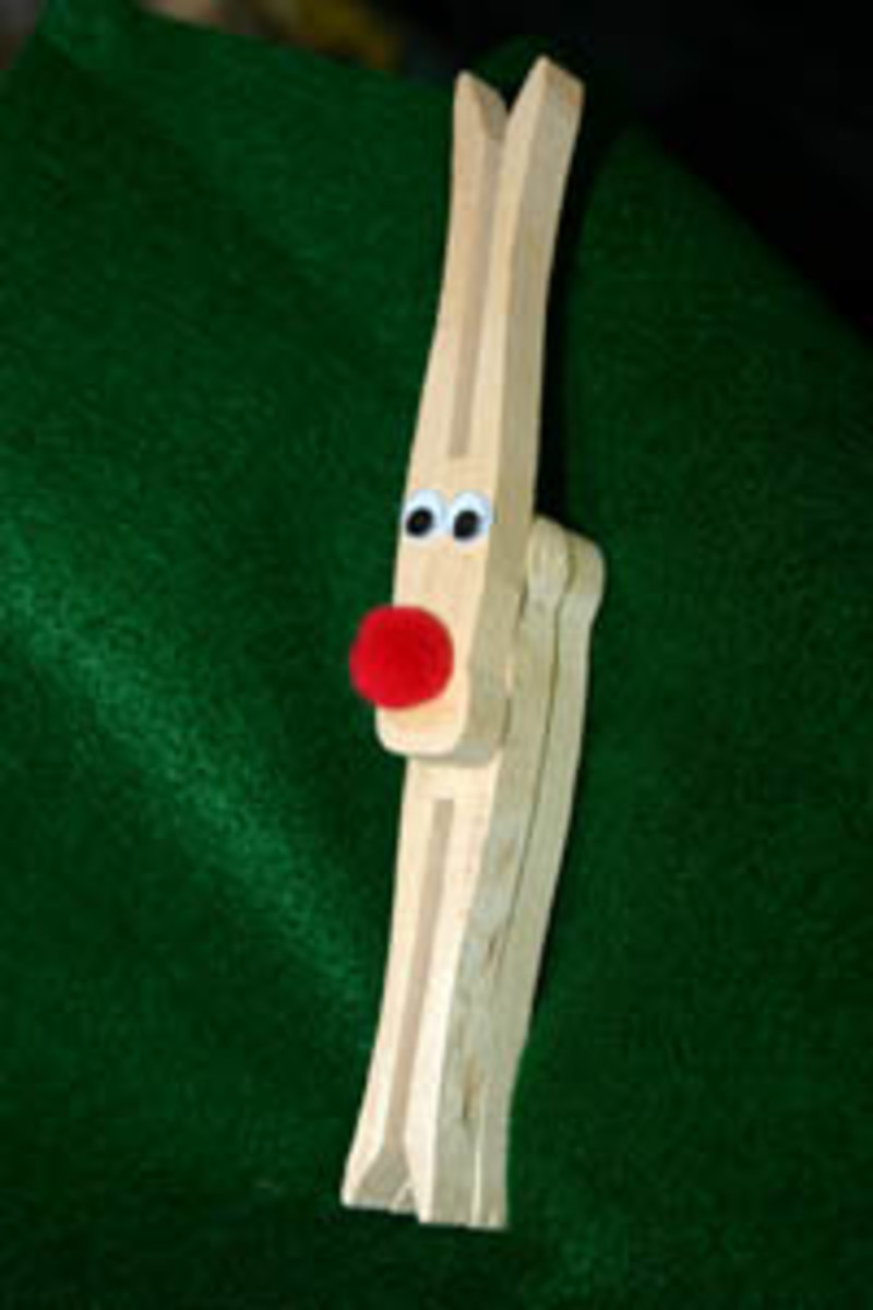 Example of the completed clothespin reindeer craft. If you like, you can paint the clothespin brown to make them look more like reindeer.