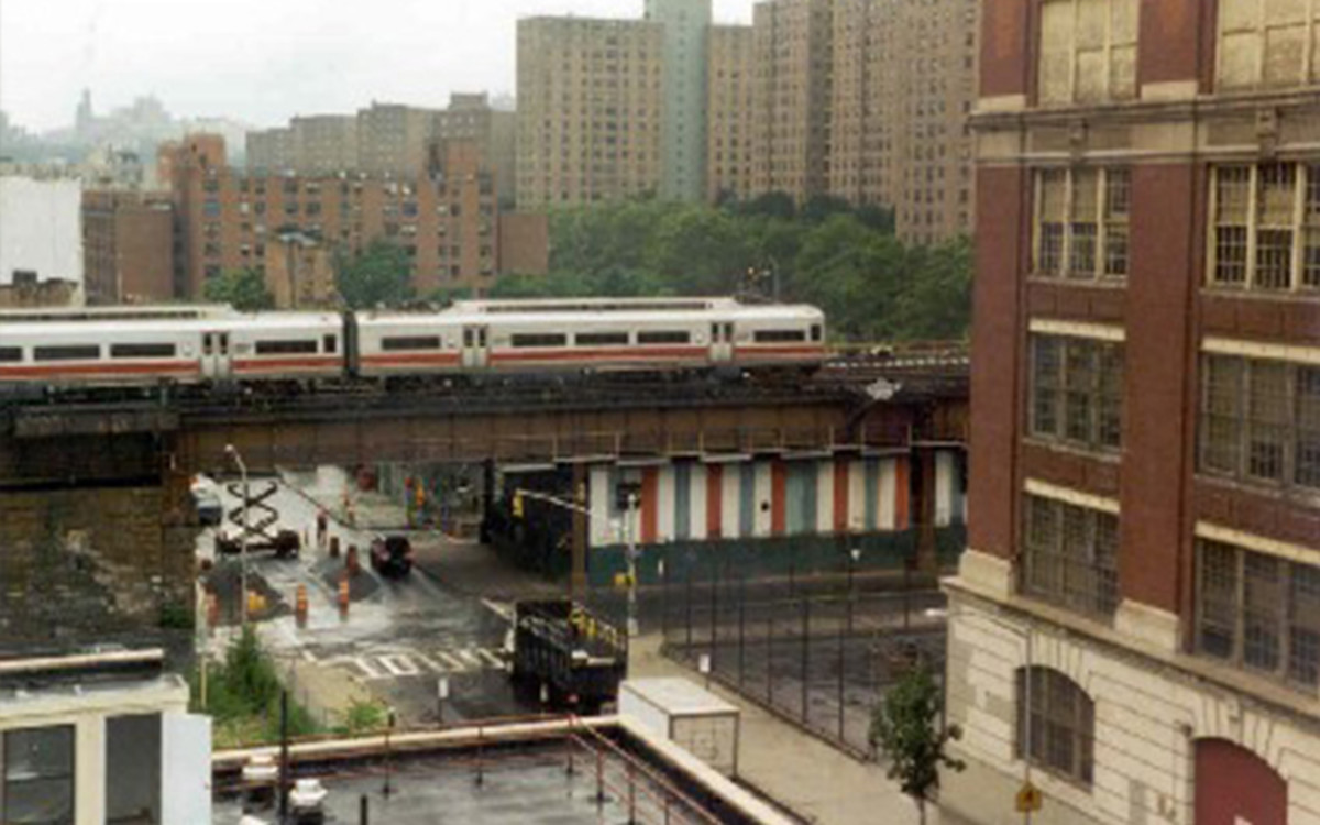 Pubic School 261 which faces Jerome Avenue in the North Bronx is situated the same way as the school in this picture on the right of this picture and in a busy street with lots of taraffic