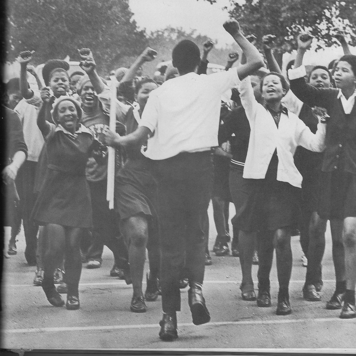 June !6th 1976, Students exuberantly Marching against being Instructed in Afrikaans Language in all their high schools courses; They were also protesting Bantu Education.