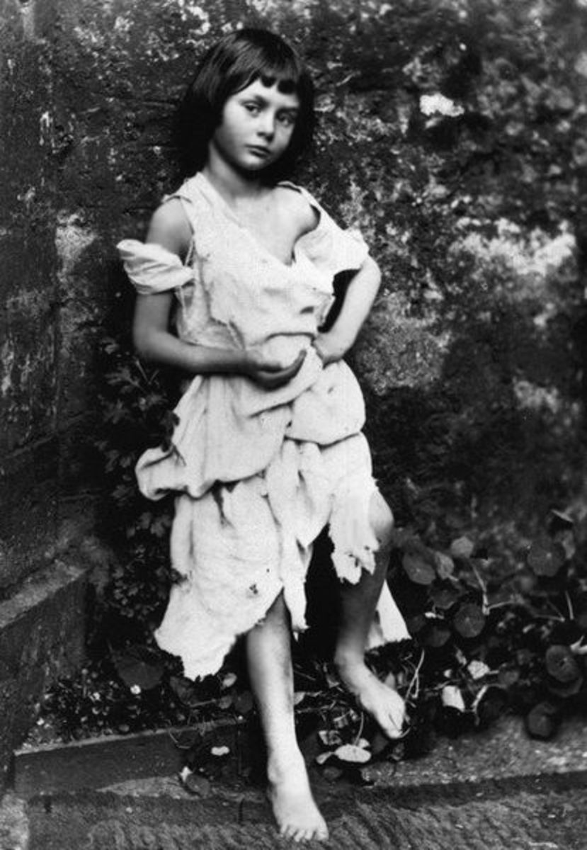 A phot of Alice dressed as a beggar maid for a play.