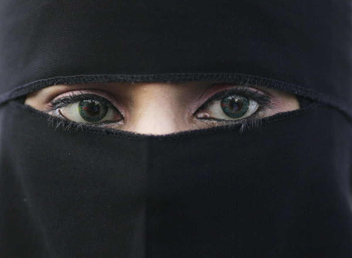 Only the woman's eyes show in this traditional Islamic clothing.