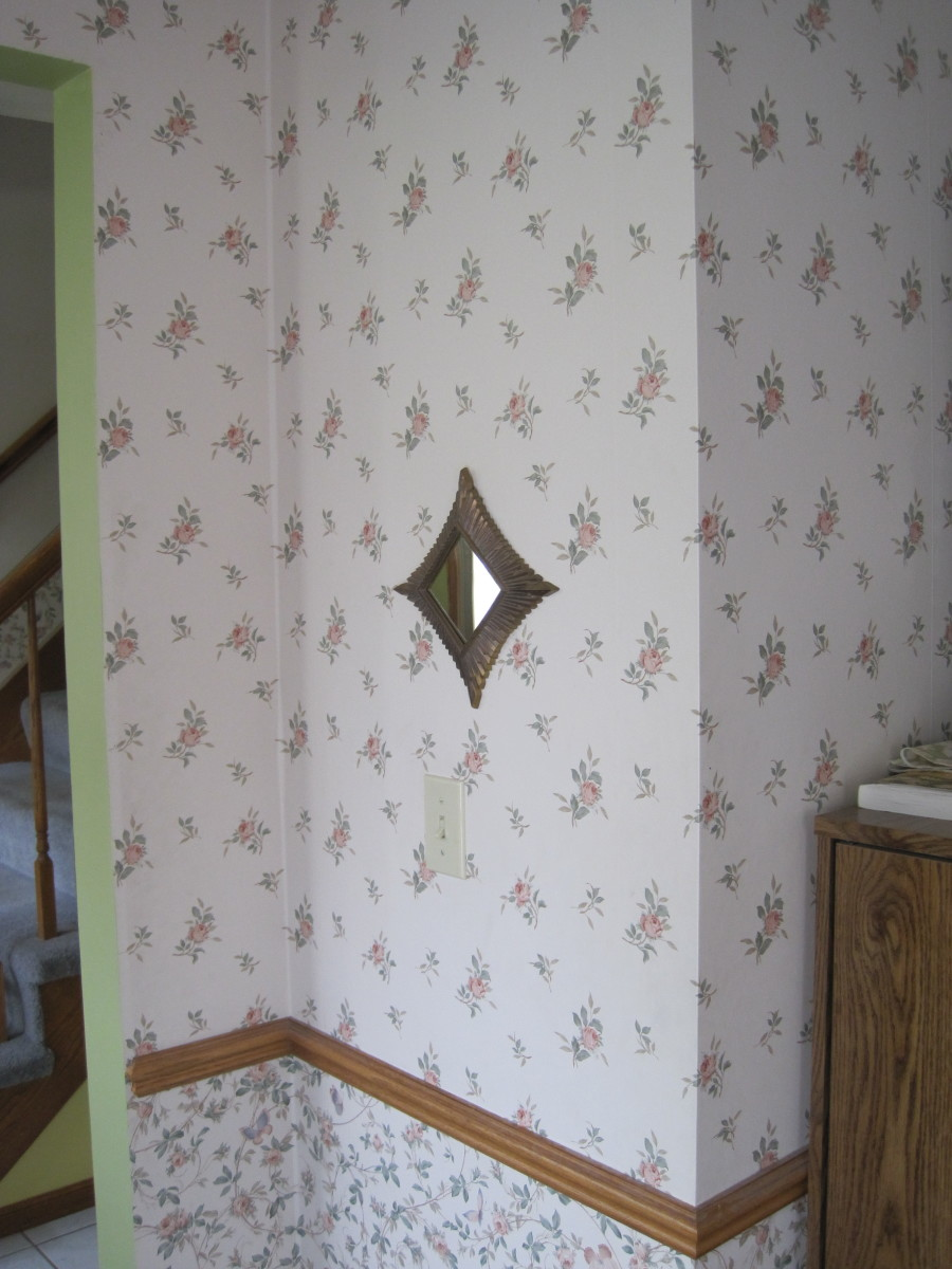 Old wallpaper waiting to be removed.