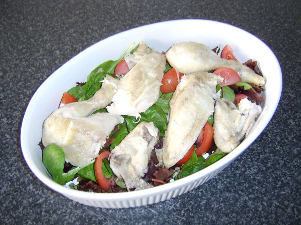 Chicken salad ready to be scattered with fresh herbs and served