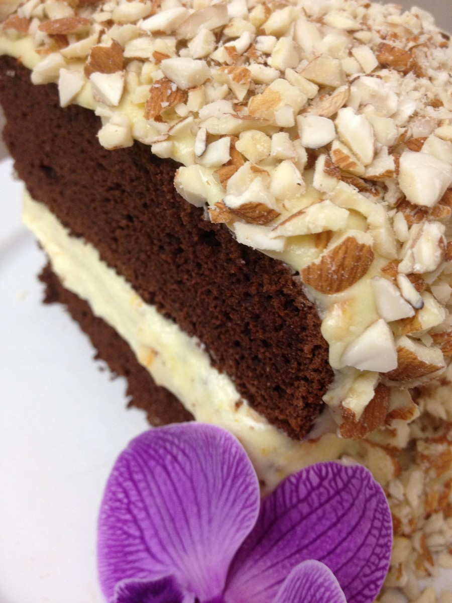 """I have baked this cake as a """"birthday cake"""" by topping the frosting with chopped (or sliced) almonds. I have to admit my cake decoration skills are a bit lacking...but it tastes better than it looks!"""