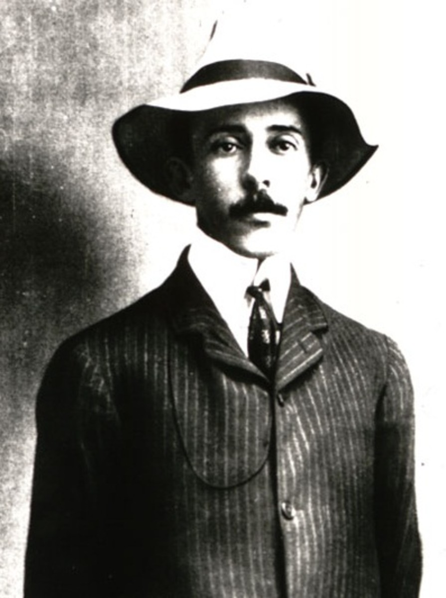 Brazilian aviation hero Alberto Santos-Dumont in his trademark high collar shirt and Panama hat.