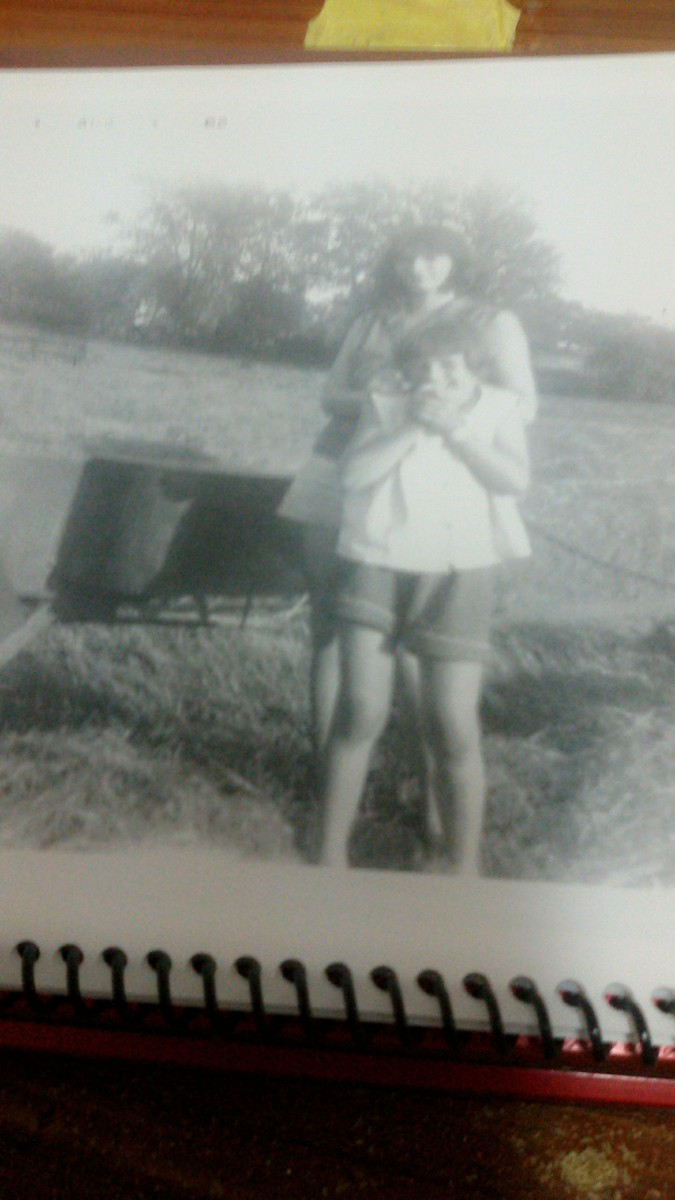 Bailing hay in 1962.  My two sisters are in the picture.