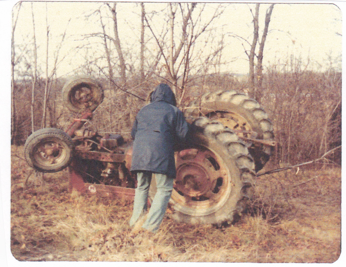 Dad's tractor that tipped over in the field.