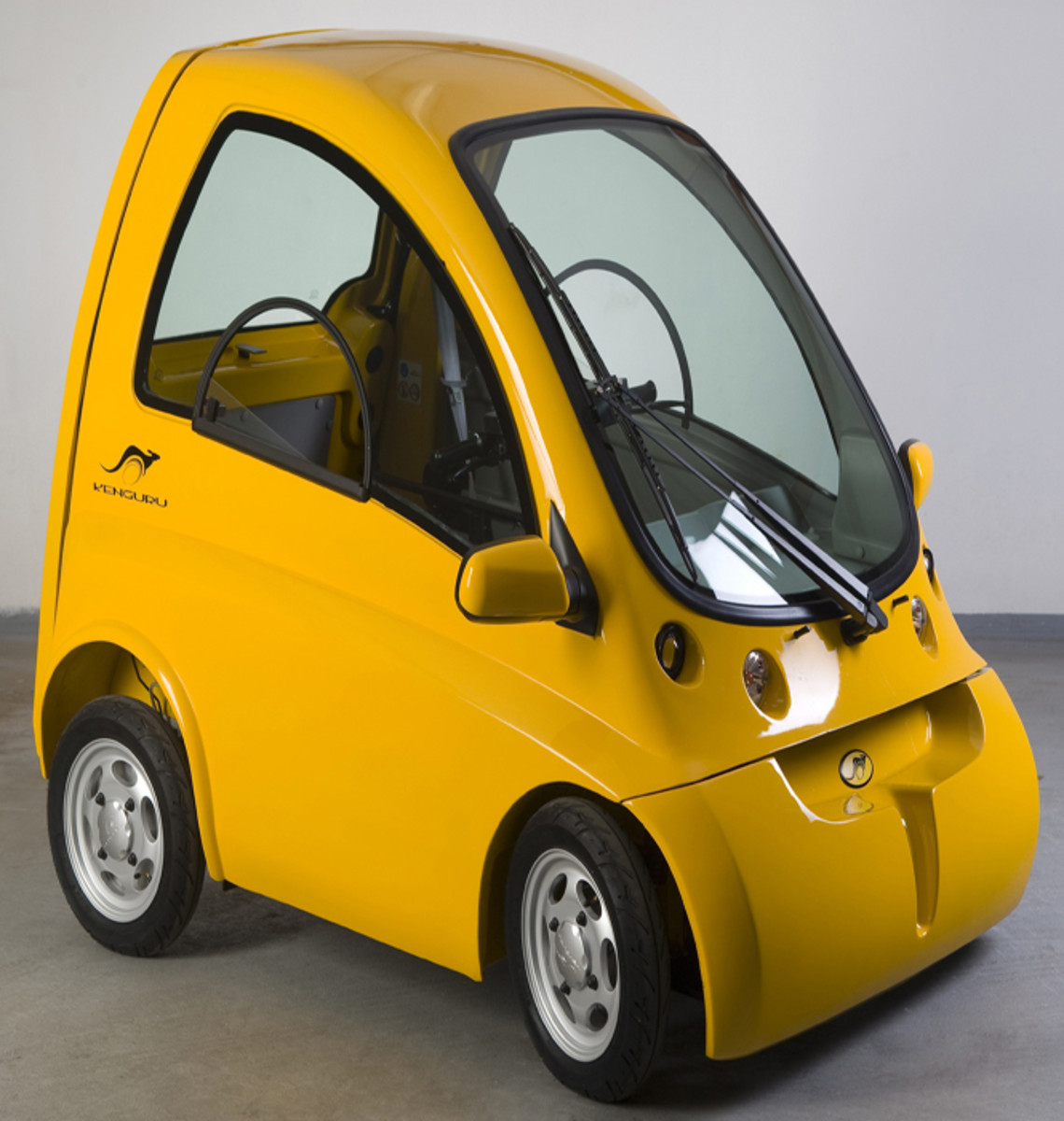Electric vehicle for wheelchair users