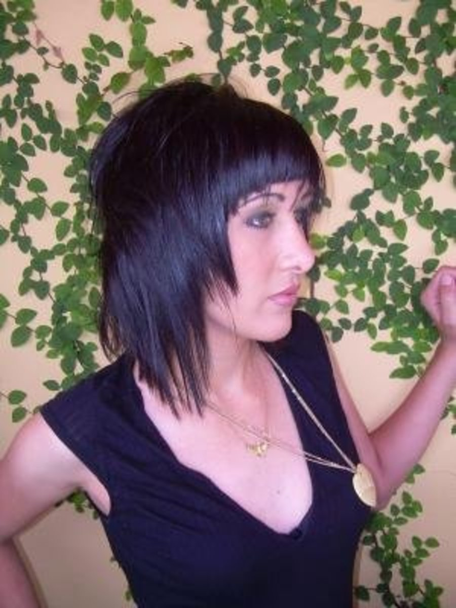 Black hair with a razor cut.
