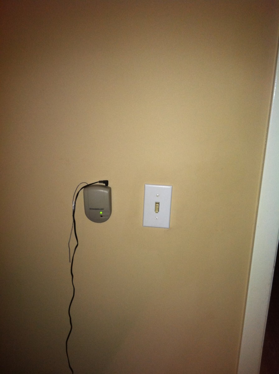 The indoor receiver, completely assembled and installed conveniently next to the master bedroom light switch.