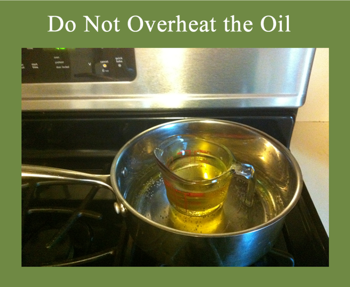 1. Heat One Cup of Olive Oil Make Warm to Touch. Be Careful Not to Overheat.