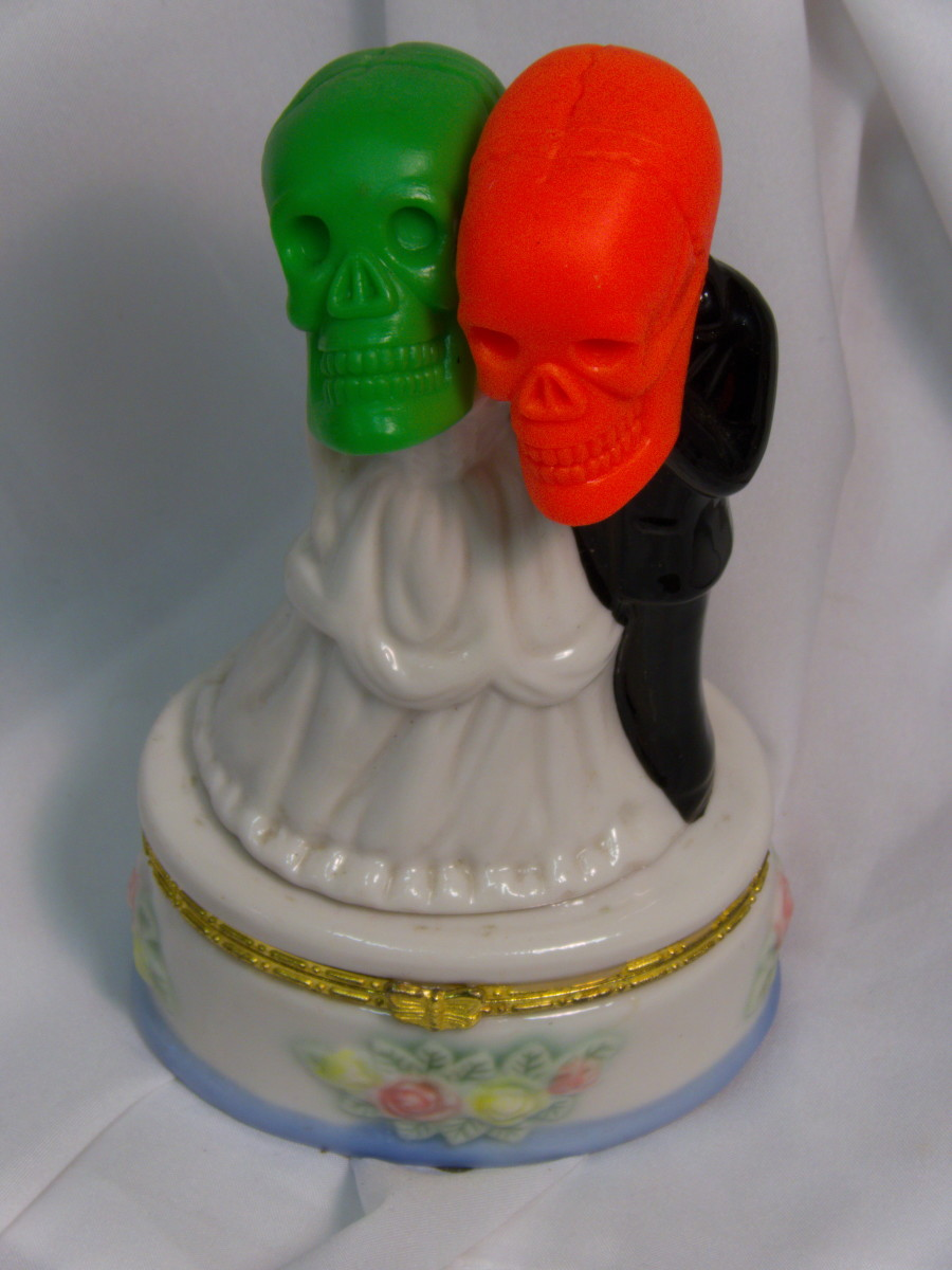 He has a sense of humor and mine like this decoration just the way it is. He is said to be fond of bones, you see.
