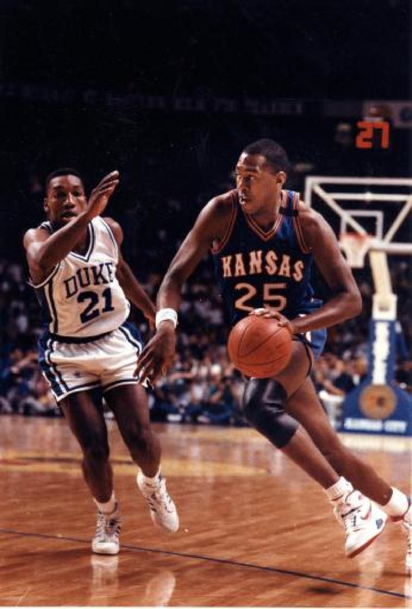 Danny Manning drives on Duke in 1988.  Manning dominated Final Four games against Duke and Oklahoma