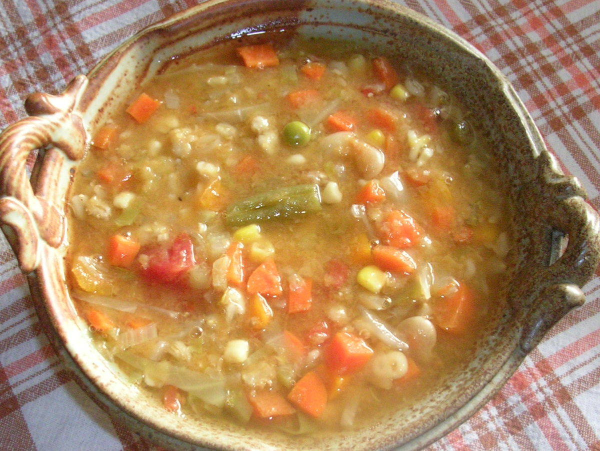 Dried legumes and grains, fresh carrots, onions, and celery, stewed tomatoes, fresh cabbage, and frozen mixed vegetables all cooked in a vegetable stock make this hearty autumn and winter vegetable soup.