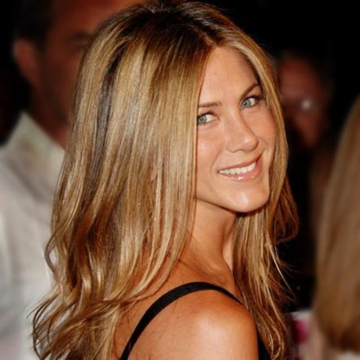 Jennifer Aniston should know better than to wear her hair long like this at 42.