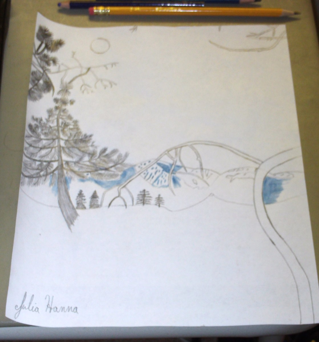 I use a violet-blue colored pencil to begin shading in the peaks of Mount Baldy.