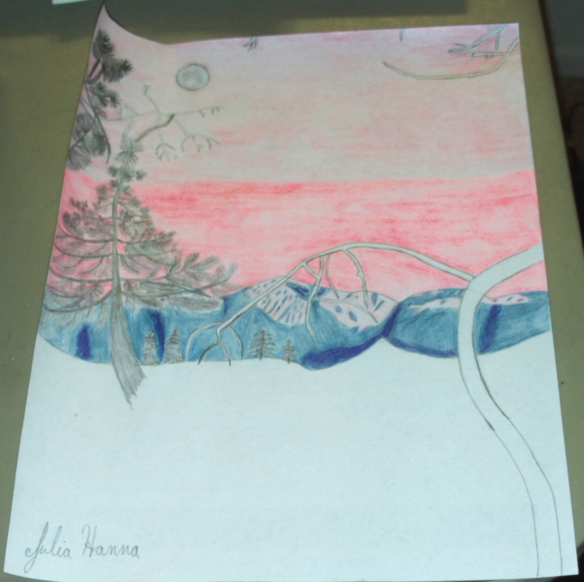 I used a two shades of gray colored pencils to create the moon in my sunset scene.