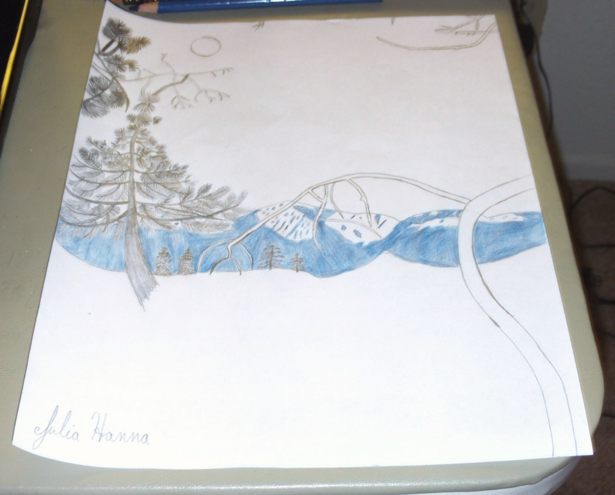 The mountains are now completely shaded in with the violet-blue colored pencil.