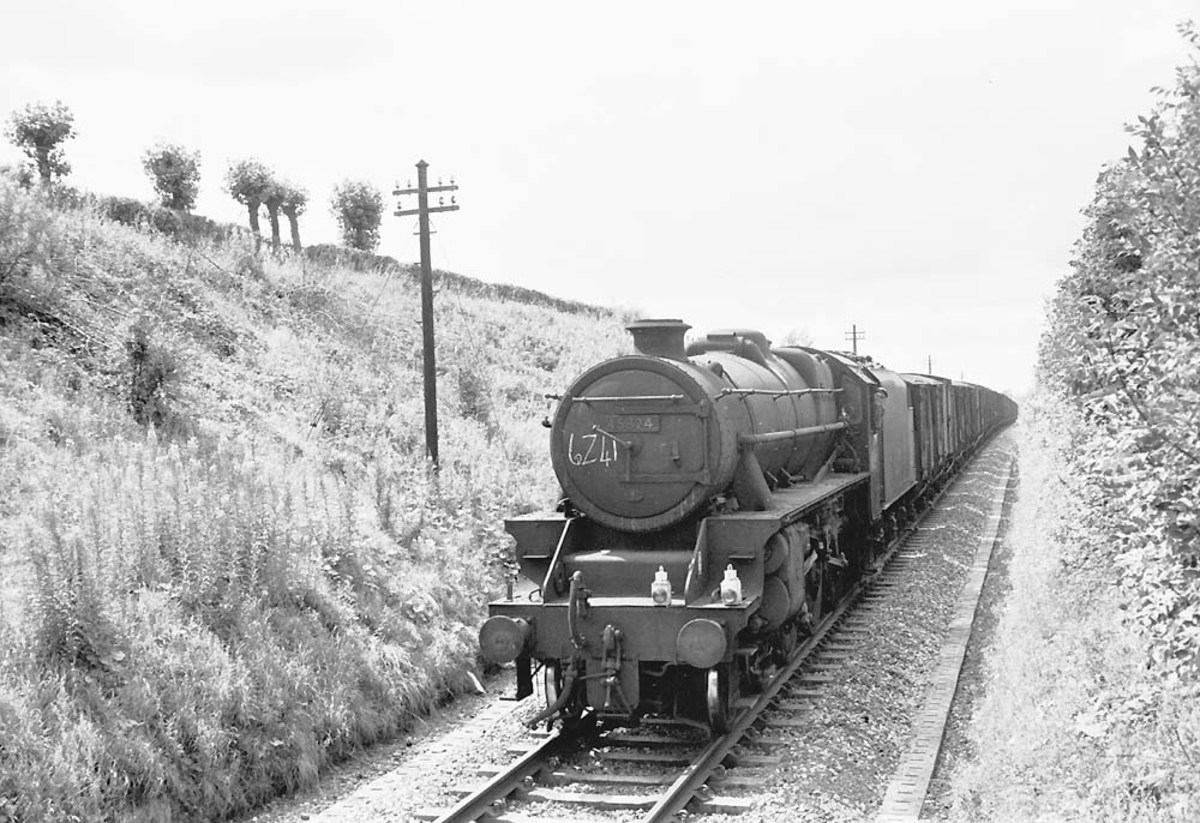Class 8F 2-8-0 ex-LMS nears Kenilworth Junction with Type 6 freight - partly fitted (note lamp code, outer right and centre)