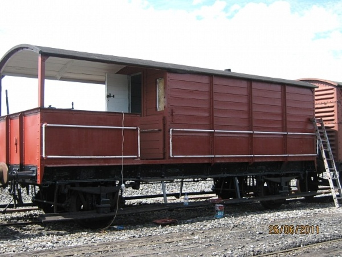 A restored fitted GW brakevan in original livery (lettering and numbering to be added)stands on the rails as an example of work undertaken by the Bury Standard 4 Group