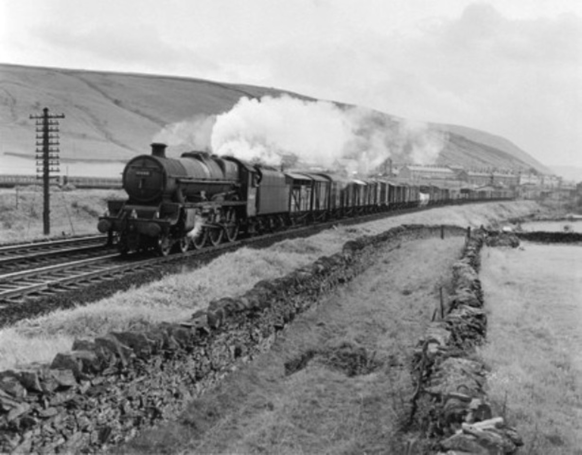 Ex-LMS 4-6-0 Patriot class 'Howe' takes a mixed freight on the Settle & Carlisle Railway through the Pennines