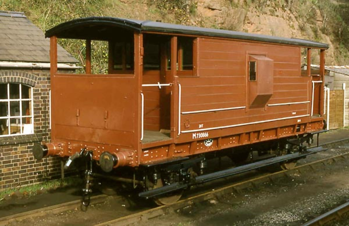 Restored to pristine condition, ex-LMS brake van in express goods bauxite livery with vacuum pipe and screw couplings for faster running