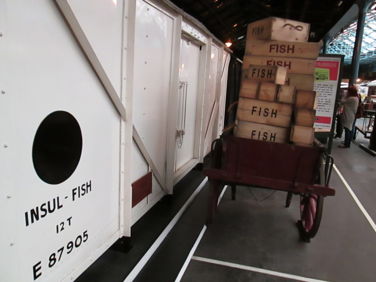 In a quiet corner of the NRM's Peter Allen building, a British Railways' built LNER designed fish van with the later 'Blue Spot' livery stands at the platform next to a trolley loaded with fish boxes